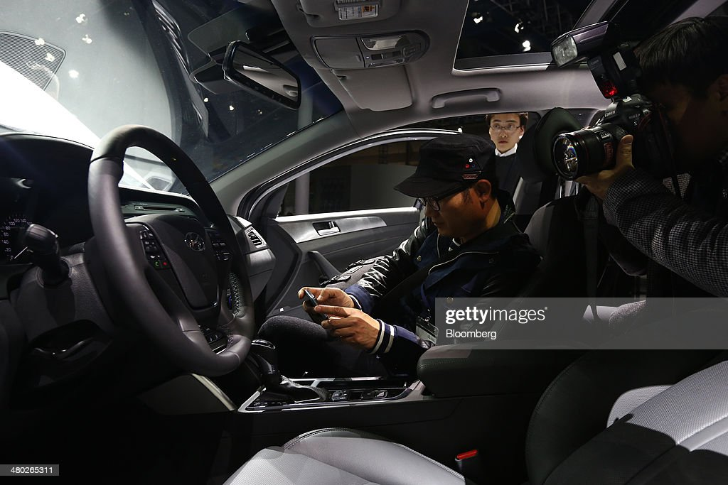 Of media take photographs of the interior of the new hyundai motor co