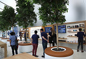 Members of media tour the 'Genius Grove' during a press preview of the new flagship Apple Store on May 19 2016 in San Francisco California Apple is...