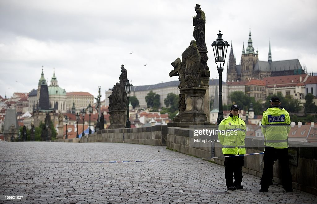 Members of Metropolitan police stand on the Charles Bridge, which is closed to the public due to flooding from the Vltava river on June 4, 2013 in Prague, Czech Republic. After days of heavy rainfall, rivers have flooded in the centre of Prague forcing people to evacuate and the risk or serious damage to the historic city. Seven people have been killed and several are missing across the country as rivers continue to rise throughout western, southern and nothern Bohemia.