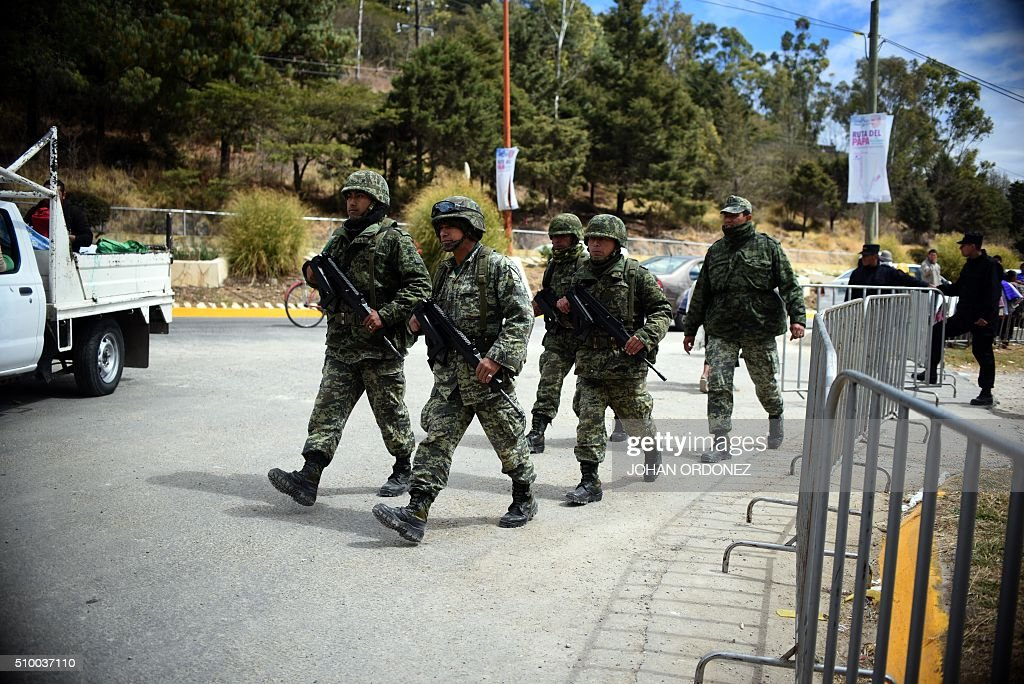 Members of Mexican Army remain where Pope Francis will offer a mass at Centro Deportivo Municipal in San Cristobal de las Casas, Chiapas State, Mexico on February 13, 2016. Pope Francis will arrive in Mexico on Friday, where he will visit until February 17. AFP PHOTO/Johan ORDONEZ / AFP / JOHAN ORDONEZ