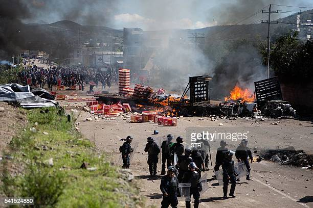 Members of Mexican Federal Police clash with teachers holding a protest against an education reform and the arrest of two of its leaders in Oaxaca...