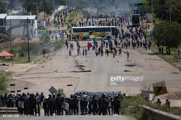 Members of Mexican Federal Police clash with teachers holding a protest against an education reform and the arrest of two of their leaders in Oaxaca...