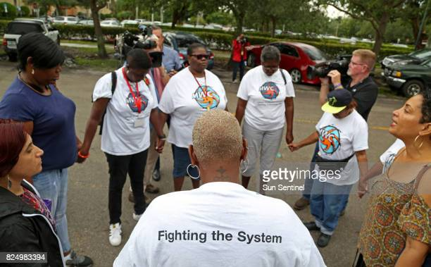 Members of Miami Workers Center a grassroots immigrants rights group pray for Reina Gomez an undocumented woman from Honduras battling a rare form of...