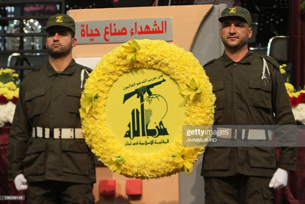 Members of militant Shiite Muslim group Hezbollah carry a wreath on the occasion of the party's Martyrs' Day in southern Beirut, on November 12, 2012.