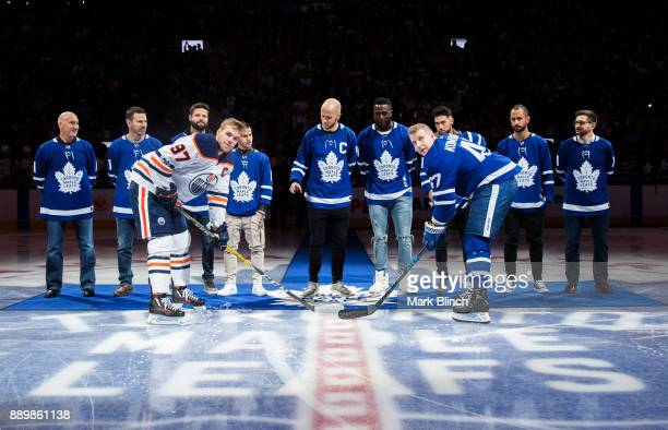 Members of MLS champions Toronto FC take part in the ceremonial faceoff with Connor McDavid of the Edmonton Oilers and Leo Komarov of the Toronto...