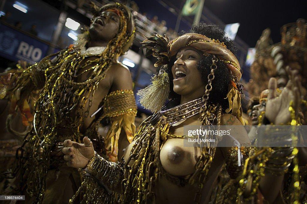 Members of Mocidade dance during the samba school's parade group A at Rio de Janeiro's carnival on February 20 2012 in Rio de Janeiro Brazil Carnival...