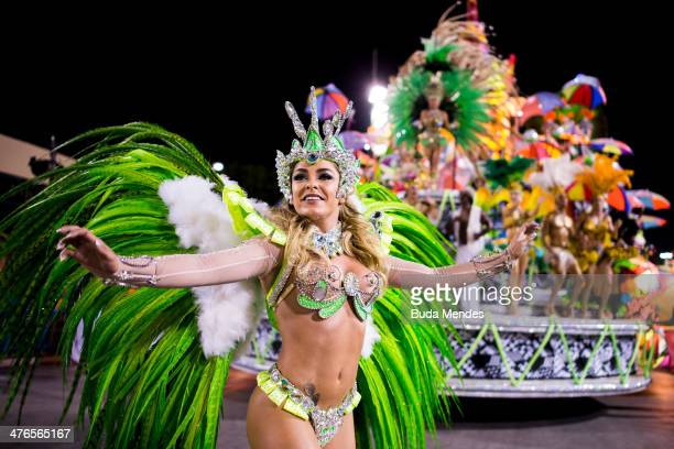 Members of Mocidade Samba School dance during their parade at 2014 Brazilian Carnival at Sapucai Sambadrome on March 03 2014 in Rio de Janeiro Brazil...