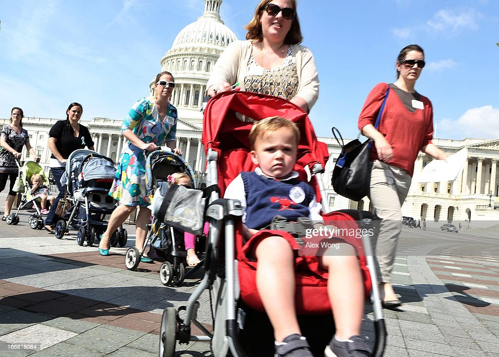 Members of Moms Demand Action for Gun Sense in America push children in strollers on their way to visit senators' offices April 17, 2013 on Capitol Hill in Washington, DC. The group held a 'Stroller Jam' event to call on senators to vote to strengthen gun regulations.