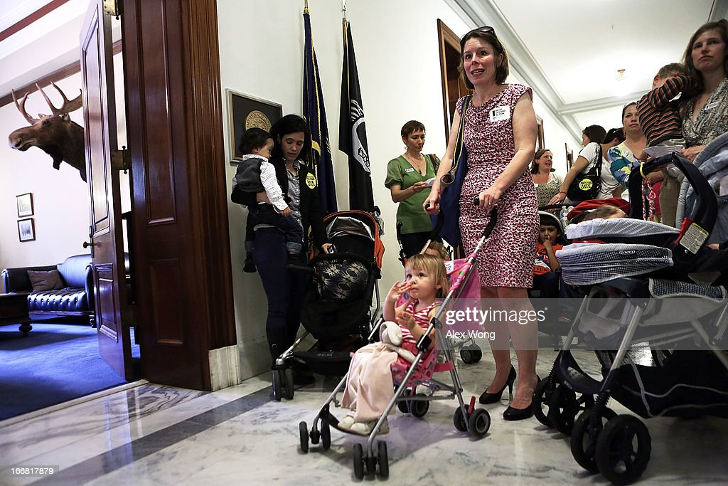 Members of Moms Demand Action for Gun Sense in America wait to enter the office of U.S. Sen. Kelly Ayotte (R-NH) at Russell Senate Office Building April 17, 2013 on Capitol Hill in Washington, DC. The group held a 'Stroller Jam' event to call on senators to vote to strengthen gun regulations.