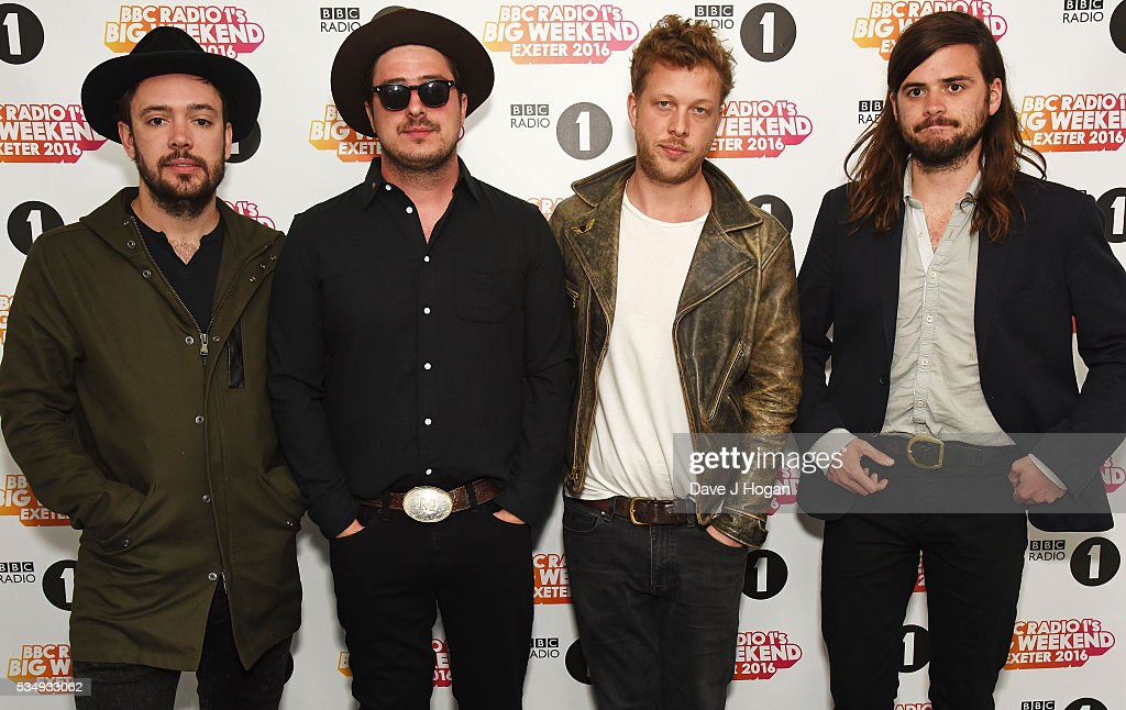 Members of Mumford & Sons pose for a photo during day 1 of BBC Radio 1's Big Weekend at Powderham Castle on May 28, 2016 in Exeter, England.