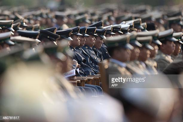 Members of Myanmar's military attend a ceremony to mark the 69th anniversary of Armed Forces Day in Myanmar's capital Naypyidaw on March 27 2014 AFP...