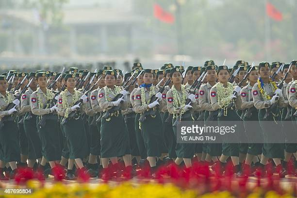 Members of Myanmar's military march in formation during a ceremony to mark the 70th anniversary of Armed Forces Day in Myanmar's capital Naypyidaw on...