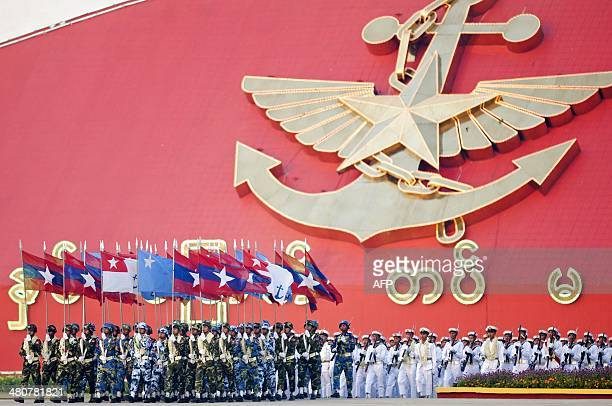 Members of Myanmar's military march in formation during a ceremony to mark the 69th anniversary of Armed Forces Day in Myanmar's capital Naypyidaw on...