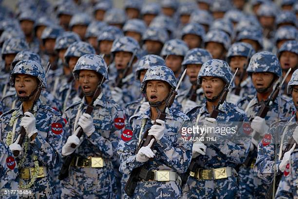 Members of Myanmar's military march in formation during a ceremony to mark the 71st Armed Forces Day in Myanmar's capital Naypyidaw on March 27 2016...