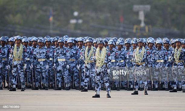 Members of Myanmar's military stand in formation during a ceremony to mark the 69th anniversary of Armed Forces Day in Myanmar's capital Naypyidaw on...