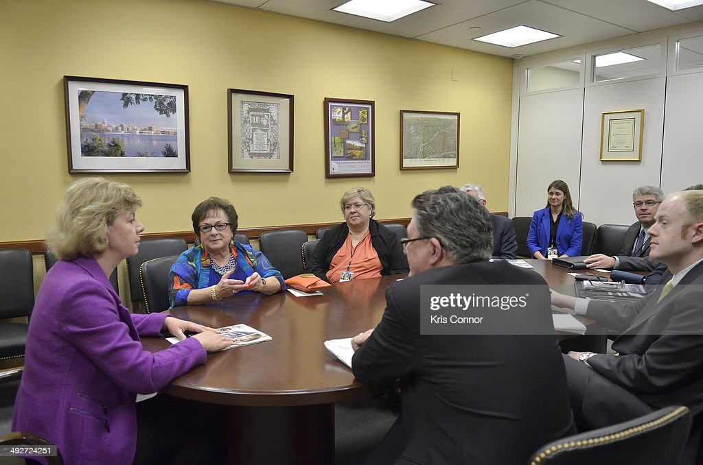 Members of NAMM meet with Sen. <a gi-track='captionPersonalityLinkClicked' href=/galleries/search?phrase=Tammy+Baldwin&family=editorial&specificpeople=4251626 ng-click='$event.stopPropagation()'>Tammy Baldwin</a>(D-WI) in her office in the Hart Senate Office Building during NAMM D.C. Fly-in at the US Capitol on May 21, 2014 in Washington, DC.