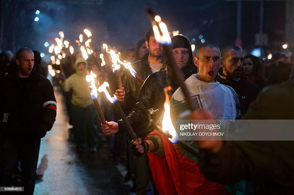 Members of nationalist organisations march with torches in the centre of Sofia on February 13, 2016. Hundreds of Nationalists gathered to commemorate General Hristo Lukov, a Bulgarian army commander during the World War I, who was killed on February 13, 1943. / AFP / NIKOLAY DOYCHINOV