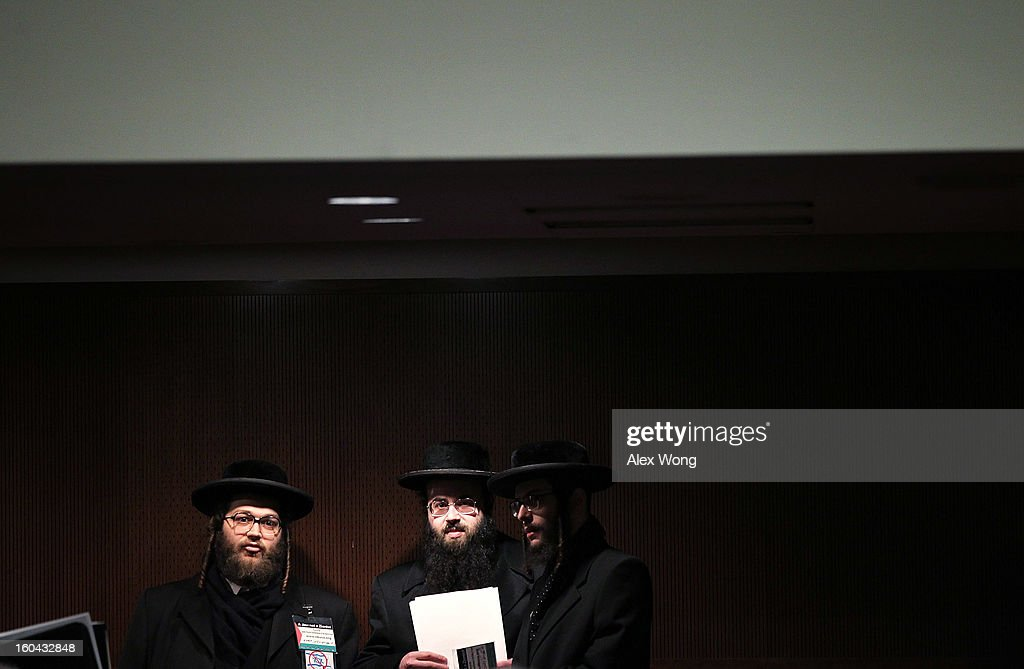 Members of Neturei Karta International Yoel Loeb (2nd L) and Yeshaye Huchoser (L) attend the confirmation hearing of former U.S. Sen. Chuck Hagel (R-NE) to become the next secretary of defense before the Senate Armed Services Committee on Capitol Hill January 31, 2013 in Washington, DC. President Barack Obama nominated Hagel, a controversial choice as Hagel opposed former President George W. Bush and his own party on the Iraq War and upset liberals with his criticism of a gay ambassador, for which he later apologized.