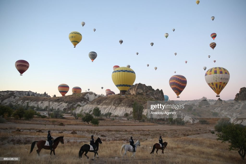 Members of Nevsehir General Commandership of Gendarmerie Horse and Dog Training Center (JAKEM) are seen on a horse as they ensure security around the historical Cappadocia region, while taking attraction of tourists in Nevsehir, Turkey on October 12, 2017. Since 2003, Gendarmerie Horse and Dog Training Center (JAKEM) has been providing service in the historical touristic place Cappadocia for both ensuring security and awaking horsemanship culture.