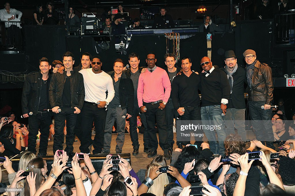 Members of New Kids on the Block, 98 Degrees and Boys II Men pose for photographers during upcoming tour announcement at Irving Plaza on January 22, 2013 in New York City.