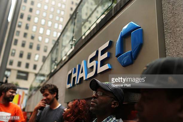Members of New York Communities for Change hold a demonstaration in front of Chase Bank demanding a citywide probe into fraudulent banking practices...