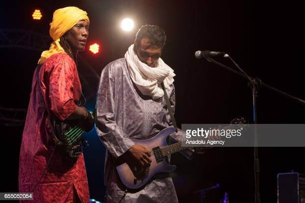 Members of Nigerian Muhtar Gomara music band perform during the 14th International Nomads Festival in M'Hamid El Ghizlane town of Zagora Morocco on...
