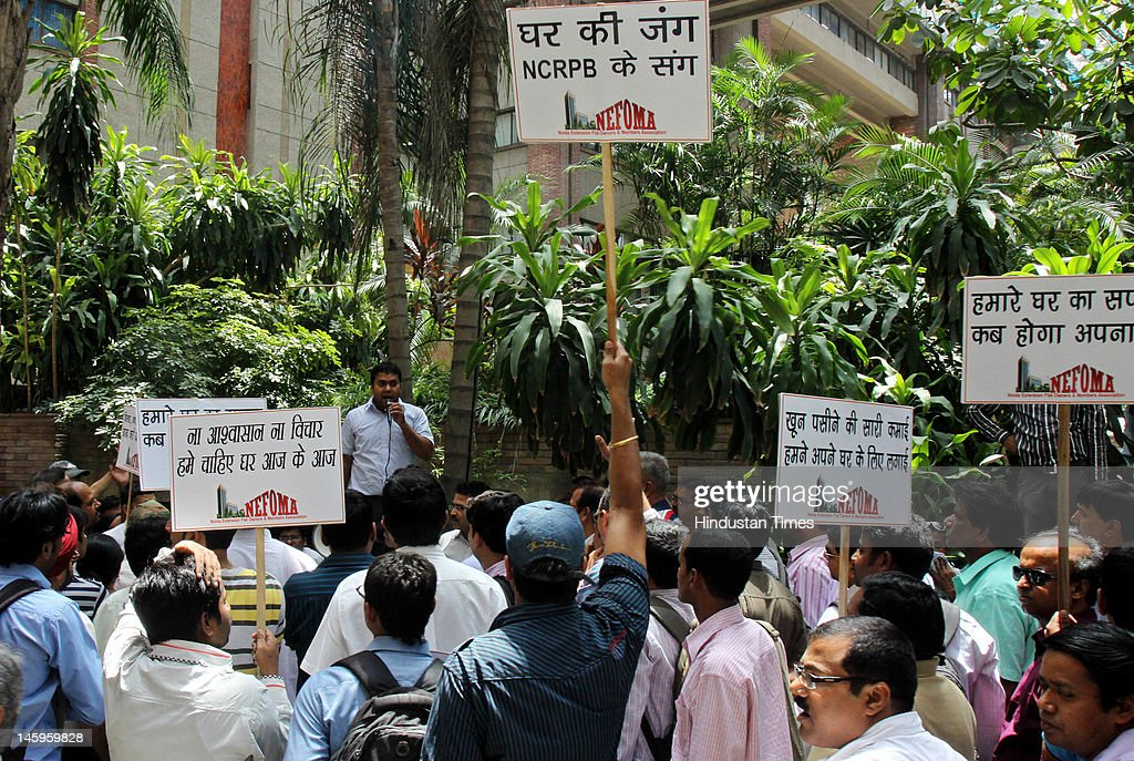 Members of Noida Extension flat owners and members association protest outside the National Capital Region Planning Board under the Ministry of Urban Development to press their demand of New houses at India Habitat Centre Lodhi Road on June 8, 2012 in New Delhi, India. Around one lakh Noida Extension buyers are affected due to the unwanted delay in Master Plan approval.