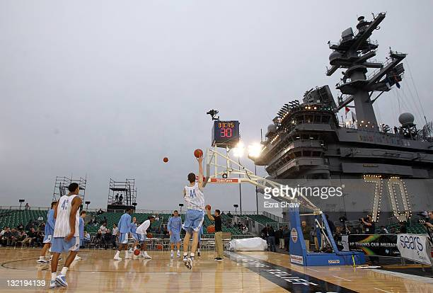 Members of North Carolina Tar Heels practice for the Carrier Classic NCAA college basketball game aboard the USS Carl Vinson on November 10 2011 in...