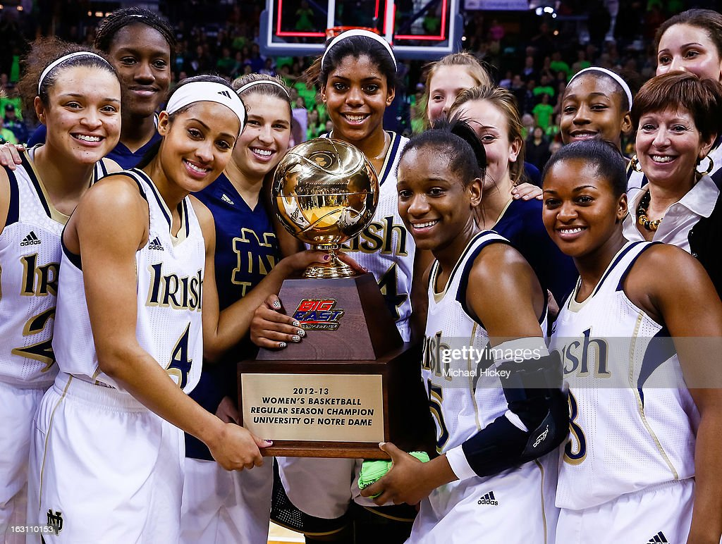 Members of Notre Dame Fighting Irish pose with the Big East regular season trophy after defeating Connecticut Huskies at Purcel Pavilion on March 4, 2013 in South Bend, Indiana. Notre Dame defeated Connecticut 96-87 in triple overtime to win the Big East regular season title.