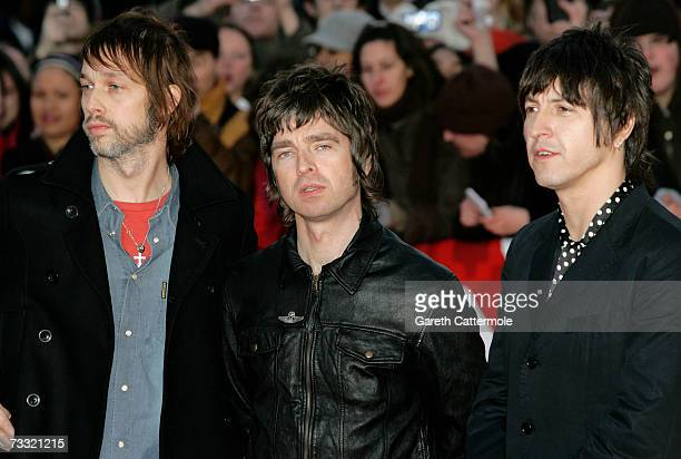 Members of Oasis Andy Bell Noel Gallagher and Gem Archer arrive at the BRIT Awards 2007 in association with MasterCard at Earls Court on February 14...