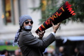 Members of Occupy Wall Street stage a protest near Wall Street in New York on October 15 2011 The Occupy Wall Street movement went global with groups...