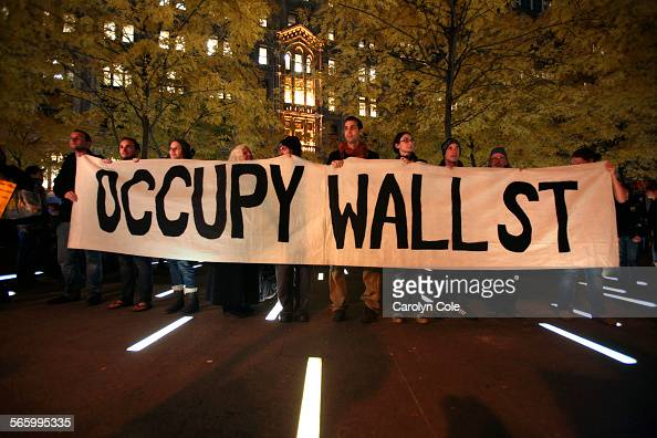 Members of Occupy Wall Street stand in triumph after a court order allowed them to reenter Zuccotti Park late Tuesday afternoon