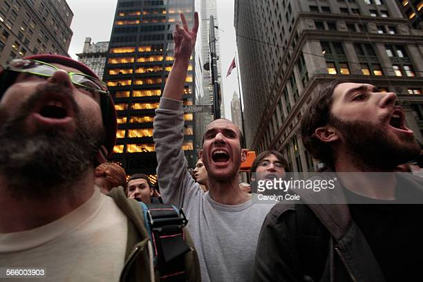 Members of Occupy Wall Street voice their opposition to being kept out of Zuccotti Park where the NYPD had set up barricades after the cleanup...
