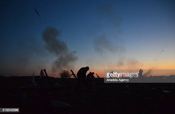 Members of opponent Sultan Murad and Mutasim Brigade attack on Daesh terrorists' positions near the Dudyan village of Aleppo Syria on March 18 2016