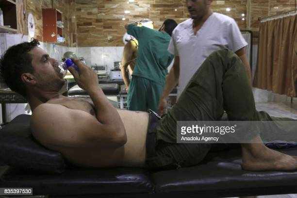 Members of opposition forces receive medical treatment at a field hospital after Assad regime's alleged poisonous gas attack over oppositions'...