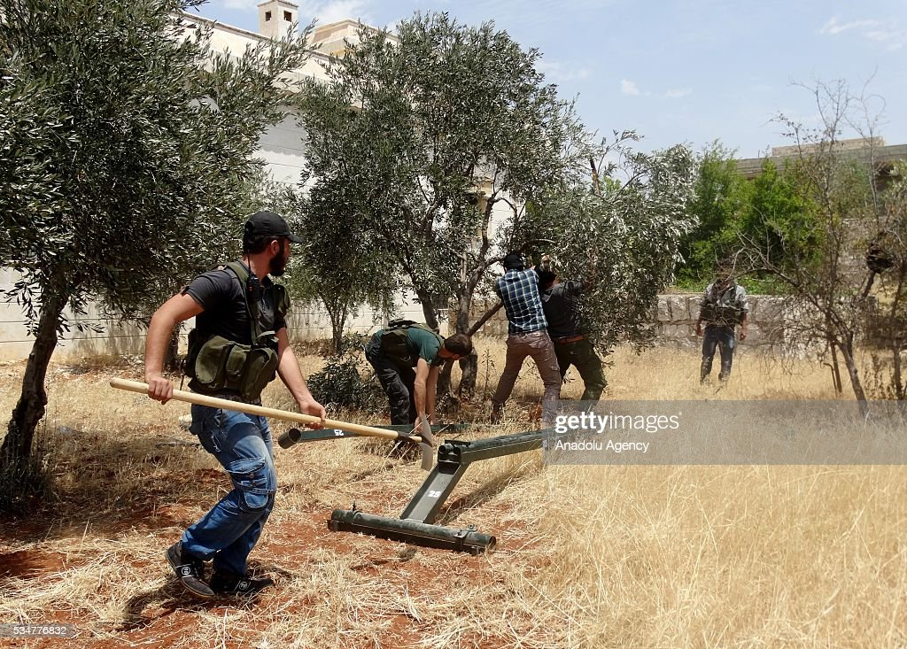 Members of opposition group Faylaq Al-Sham (Sham Legion) stage a missile attack against Assad Regime forces, located Military Academy building in Aleppo, Syira on May 27, 2016.