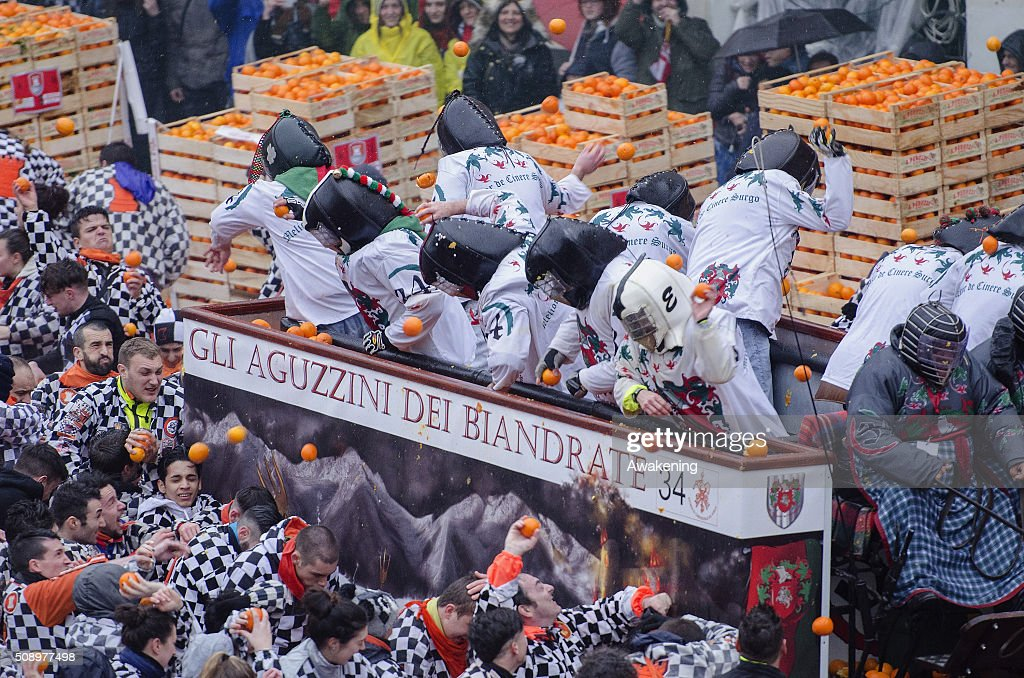 Members of orange battle teams take part in the traditional 'battle of the oranges' held during the Ivrea Carnival on February 7, 2016 in Ivrea, near Turin, Italy. During the event which marks the people's rebellion against tyrannical lords who ruled the town in the Middle Ages, revellers parading on floats represent guards of the tyrant, while those on foot the townsfolk.