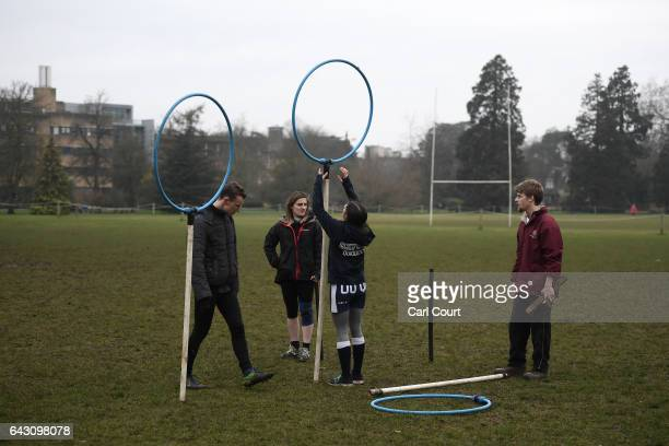 Members of Oxford University Quidditch team prepare for a training session on February 8 2017 in Oxford England Quidditch is the fictional game...