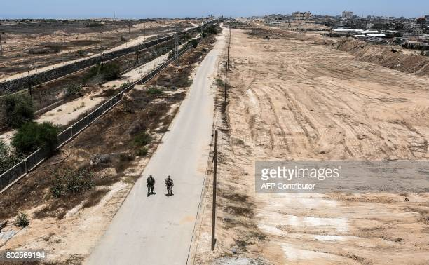 Members of Palestinian security forces loyal to Hamas patrol a section of the border with Egypt in the southern Gaza strip town of Rafah on June 28...