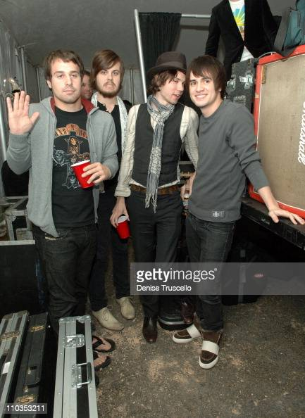 Members of Panic At The Disco Spencer Smith Jon Walker Ryan Ross and Brendon Urie attend the grand opening of Guitar Center on November 15 2007 in...