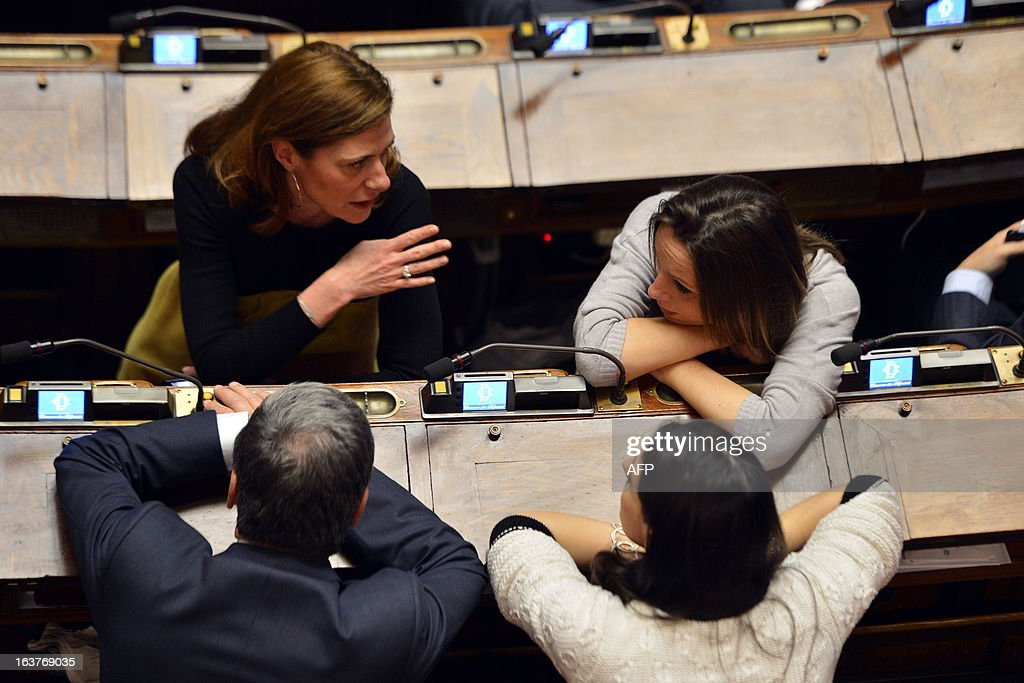 Members of parliament chat during the first session of Italian lower-house on March 15, 2013 in Rome. General election in Italy took place on February 26 but as a majority in both chambers of parliament is required to form a government, Italy is left in a state of limbo with a hung parliament that is unprecedented in its post-war history.