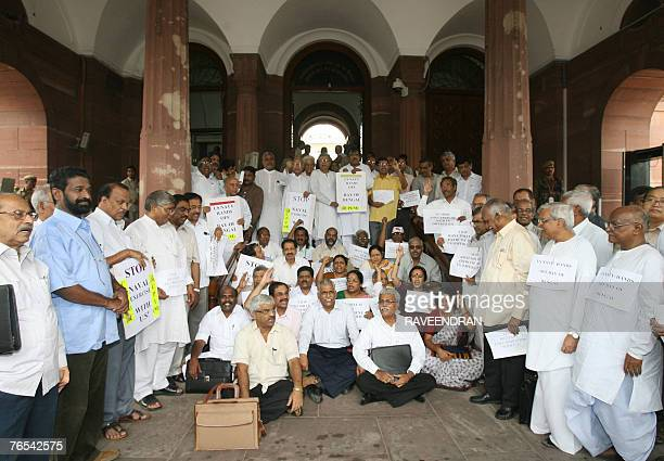 Members of Parliament from all the Left parties shout antiCongressled United Progressive Alliance Government slogans at Parliament House in New Delhi...
