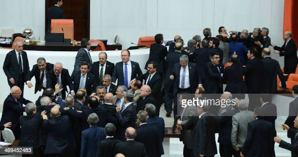 Members of parliament from the ruling AK Party and the main opposition Republican People's Party scuffle during a debate on a draft law which will...