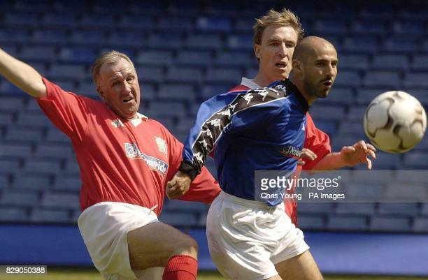 Members of Parliament Ivan Henderson and Jim Murphy struggle to catch up with former Chelsea star Gavin Peacock during a charity football match at...