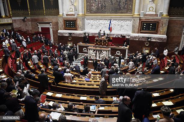 Members of Parliament leave after votint for the new map of French regions on July 23 2014 at the National Assembly in Paris French lawmakers voted...