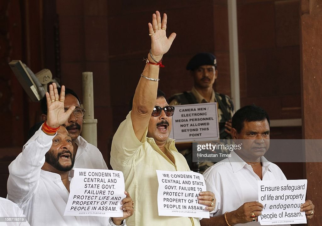 'NEW DELHI, INDIA - AUGUST 8: Members of Parliament of Asom Gana Parishad demanding protect life and property of the people in Assam, at Parliament House on August 8, 2012 in New Delhi, India. (Photo By Arvind Yadav/Hindustan Times via Getty Images) '
