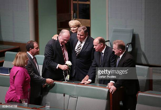 Members of Parliament remove the white rose that was placed as a tribute to West Australian MP Don Randall who died during the winter break after...