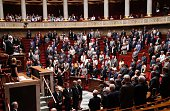 Members of parliament stand as they observe a minute of silence in memory of the victims of the attack in Nice on July 14 2016 during a session of...