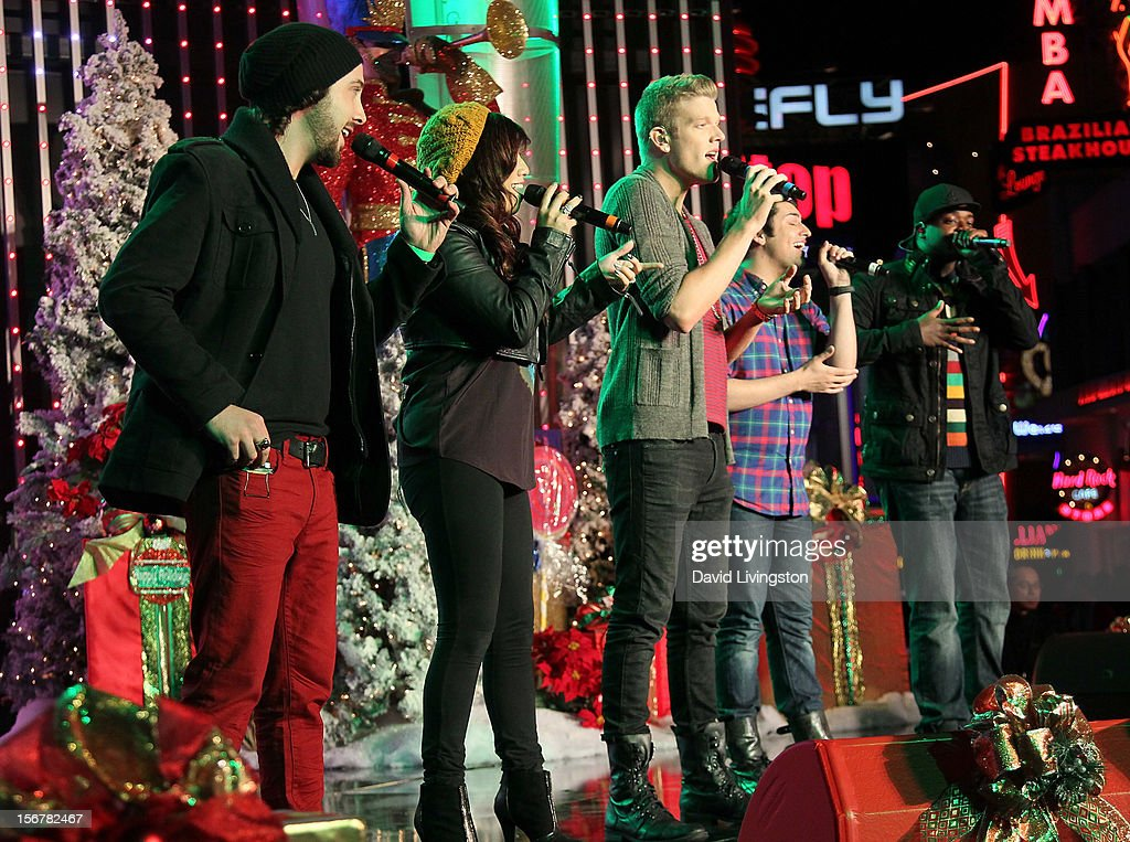 Members of Pentatonix perform on stage at Associated Television International's 2012 Hollywood Christmas Parade Concert at Universal CityWalk's 5 Towers on November 20, 2012 in Universal City, California.