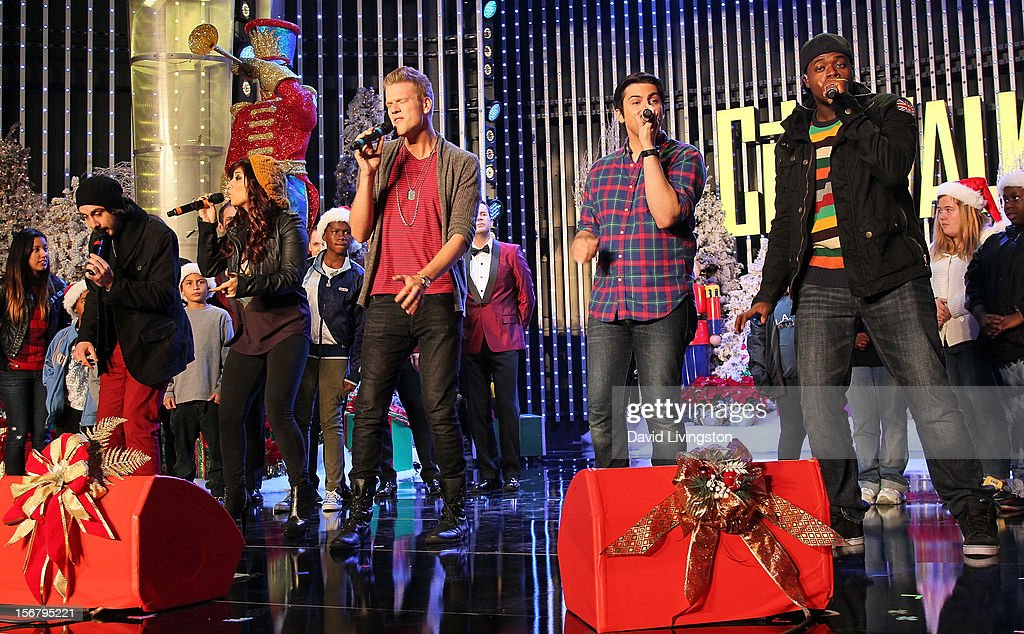 Members of Pentatonix perform on stage at the Universal CityWalk Tree Lighting - Light Show Spectacular at 5 Towers Outdoor Concert Arena on November 20, 2012 in Universal City, California.